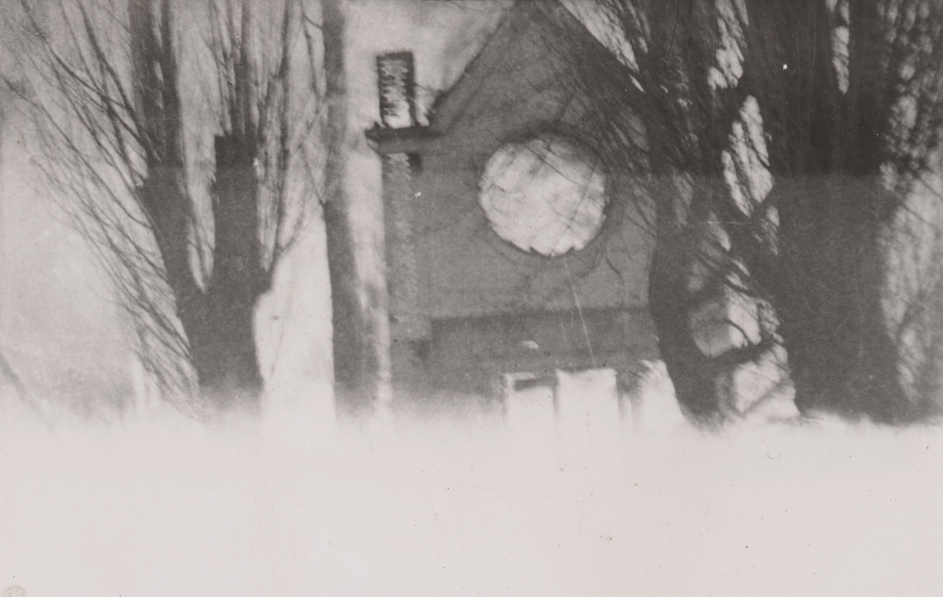 [Photo of a burning church fading into white.]